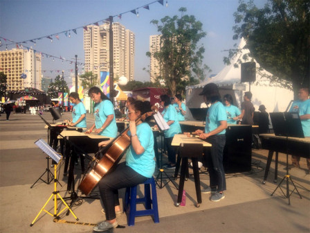 Traditional Music Performance Entertains Asian Fest Visitors