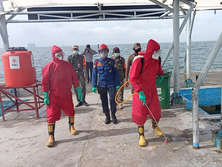 Untung Jawa Island Pier Sprayed with Disinfectant