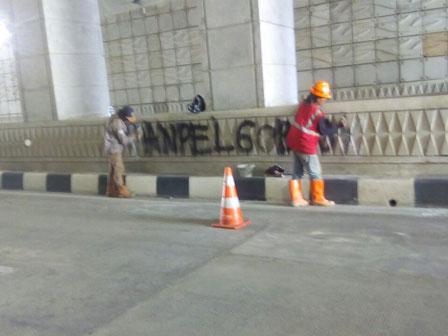Graffiti on Mampang-Kuningan Underpass' Wall Erased