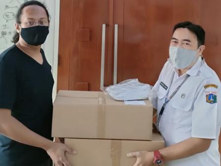Kelurahan Kebagusan Terima Bantuan Ribuan Masker dan APD