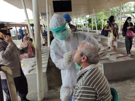 Tourists Take Rapid Antigen Test on Arrival at Pramuka Island Main Pier