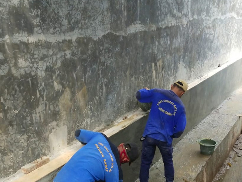 Perbaikan Saluran dan Pagar Tembok Jl. Delima 9 Jakbar